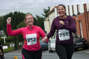 Participants celebrate as they cross the finish line